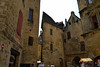 The Renaissance     <br />   <br /> The Hundred Years War completely devastated the Périgord region that found itself at the forefront of this Franco-English conflict.  <br />  <br />  However, Sarlat was relatively spared because the enemy was never able to take it, whether by force or by contract. Once the hostilities ended, King Charles VII wanted to reward the town's faithfulness to the kingdom of France, while also understanding the political and economical interest in keeping the city under his thumb. He granted the city help to reinforce its fortifications, as well as a certain number of privileges to bring the population that had fled back behind the city walls. This royal support was a real godsend for Sarlat. All the wooden and cob houses (similar to adobe) were scraped and a brand new town rebuilt out of a particular stone with golden glints whose warmth and beauty can still be admired today. Sarlat was quick to reclaim its former dynamism and prosperity as a commercial city and a town that attracted fairs. The big bourgeois families who ran the city embellished their townhouses, and the architecture that one can see today bears witness to a peaceful 16th century that the region experienced before the wars of religion came back once more to disrupt its tranquility.