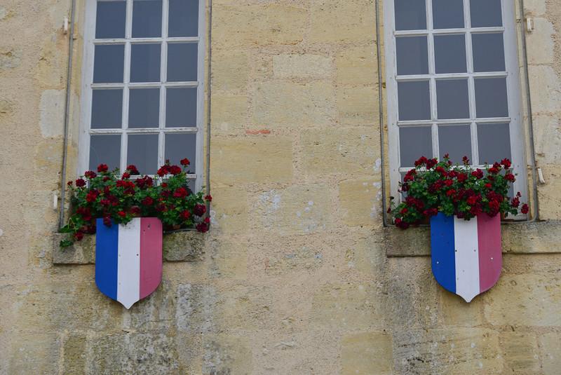 Window on the Mayor's office building in Blasimon