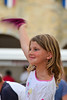 Young girl waving to the music at Blasimon market