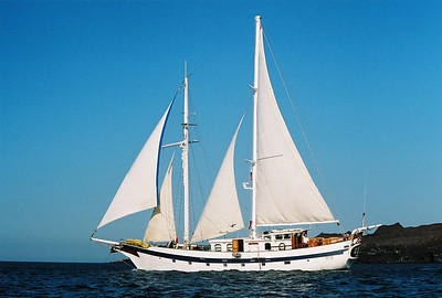 Our sailboat - The Diamant (often seen as Diamante, but I will stick to the spelling carved on the boat).  That's Capt. Max waving to us.