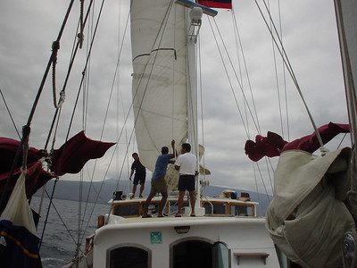 Raising the sails - they actually did this more than we were told to expect.  Randy got to help out once, I was down in the cabin sleeping through it.
