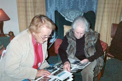 Mom and Aunty Mary looking at photos