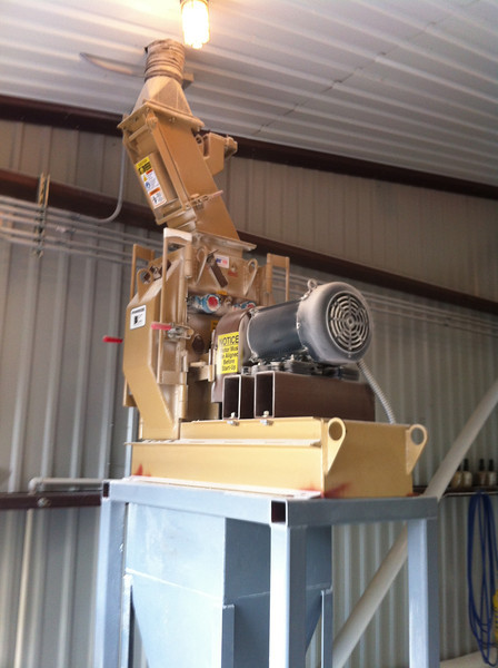 Hammer mill that grinds the grains.