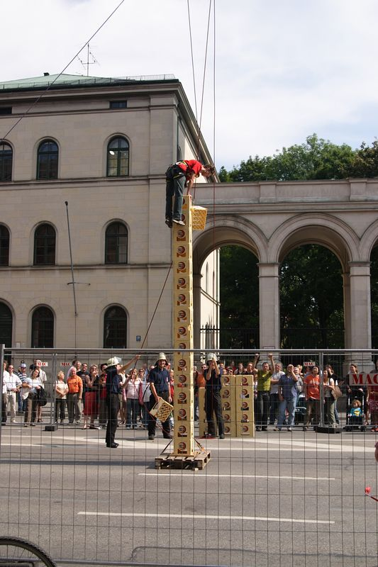 Street Fair - <br /> <br /> A contest to see who can climb the highest on milk crates.  The fire department harnessed each contestant and passed cartons on a rope.  The boy in this picture climbed 23...far more than anyone else.