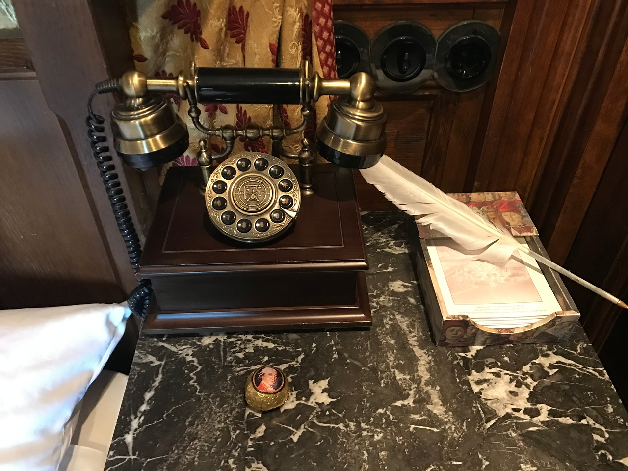 "An antique telephone and a ""quill"" pen!"