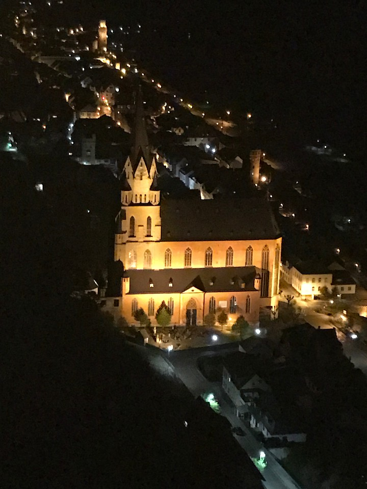Looking down on Oberwesel after dark, the Liebfrauenkirche church in the foreground.