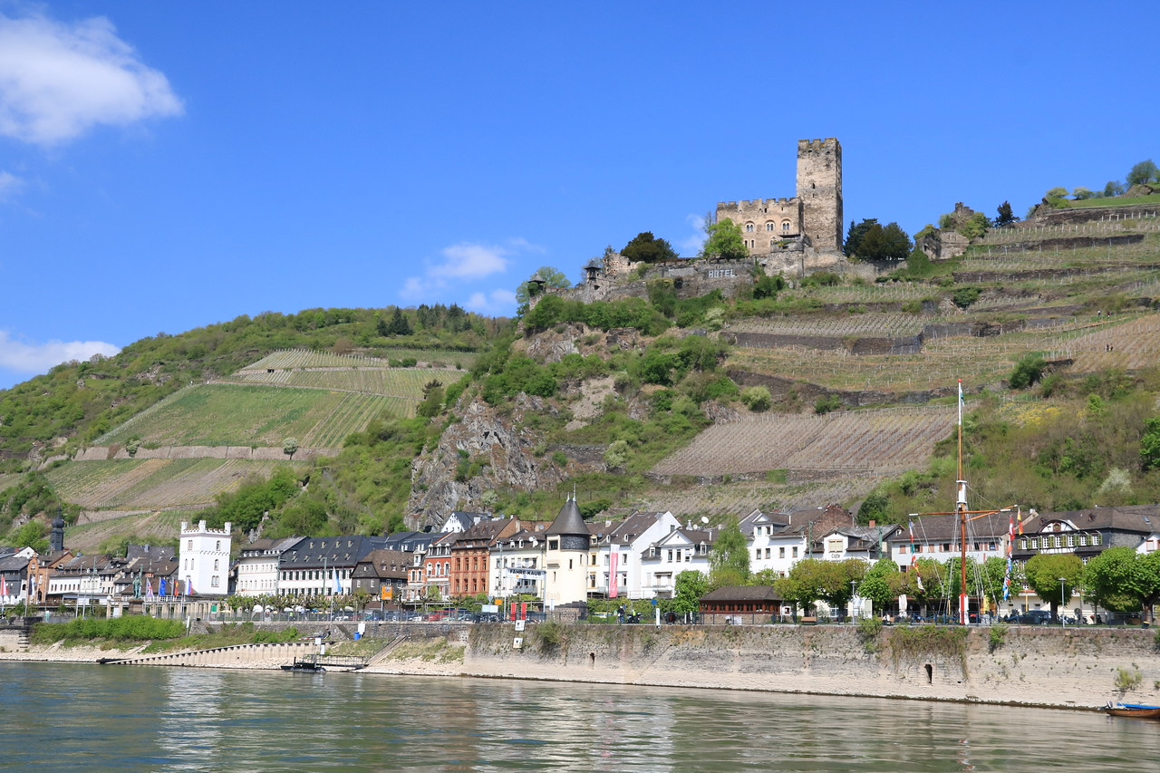 The town of Kaub and Gutenfels Castle.  Together with Pfalzgrafenstein, they would have made a strong fortification to collect tolls from passing ships.  Note that this side of the river was the only navigable side.  The other side had steep rapids and essentially prevented travel on the left side of Pfalzgrafenstein, forcing ships into this narrow passageway.  Those rapids were removed in the 1800s and the other side is now the main passageway.