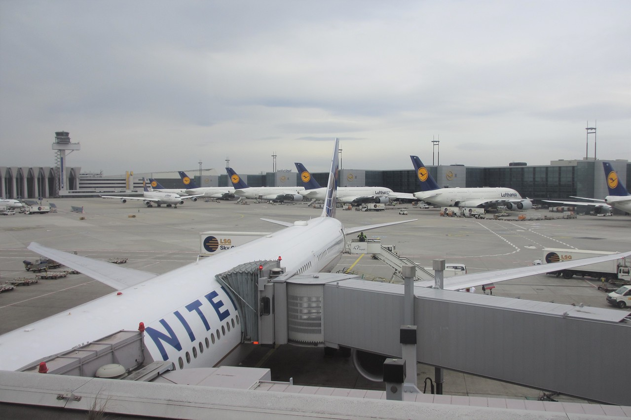 Our plane in the foreground.  In the distance are  a number of Airbus 380s, the largest airplanes in the world.  It has a capacity of 850 people in its two decks, compared to a little over 200 for our Boeing 757, which is not really a small plane.