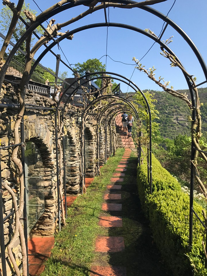 Walking through an arbor to the castle gardens.
