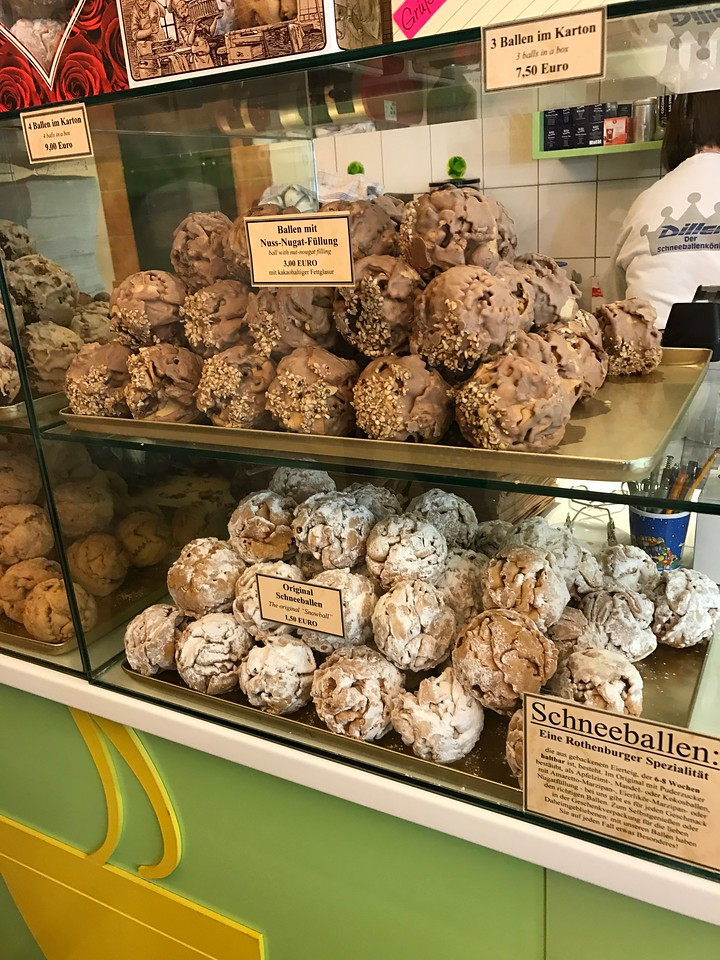 Schneeballen, supposedly a Rothenburg speciality were delicious.  They came in many flavors including white and dark chocolate, nugat, sugar, etc.  We tried several and they were, indeed, great.  They are baked dough with the filling injected into them.  You break them up and eat the pieces!