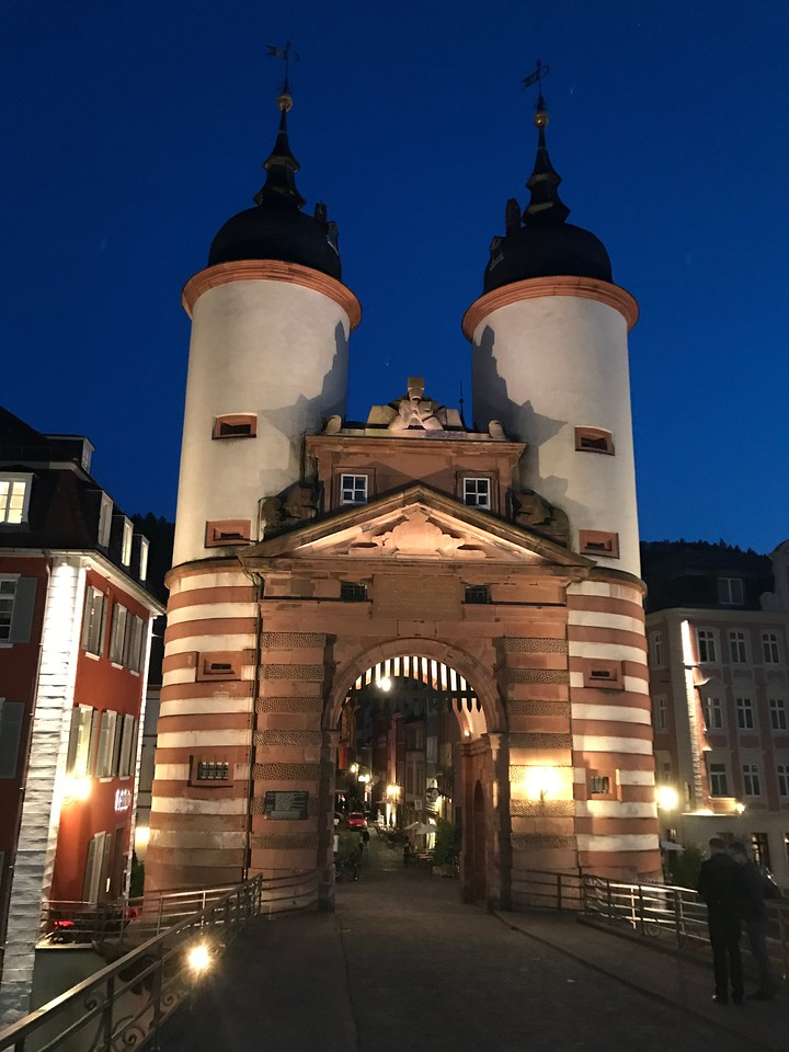 The old city gate at night at the foot of the Alte Brucke.