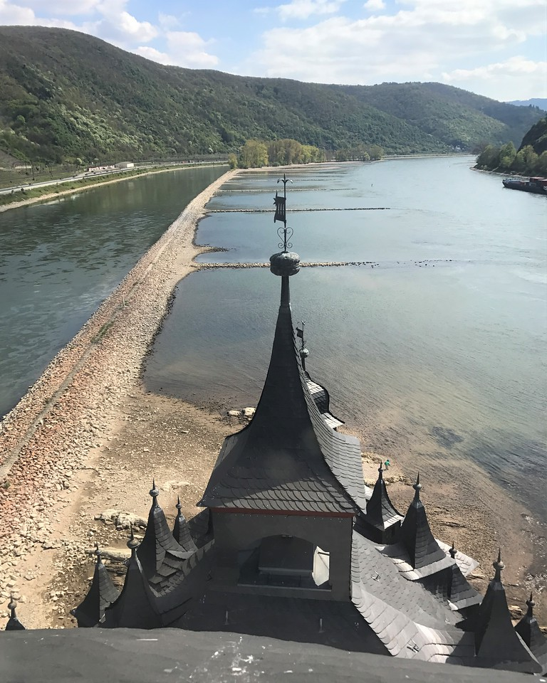 "Looking out over the ""front"" of Pfalzgrafenstein Castle at the up-river side of the Rhine.  Note that in the castle's use as a toll station, ships had to use the narrower left side because of very rough rapids on the right side which have since been removed."