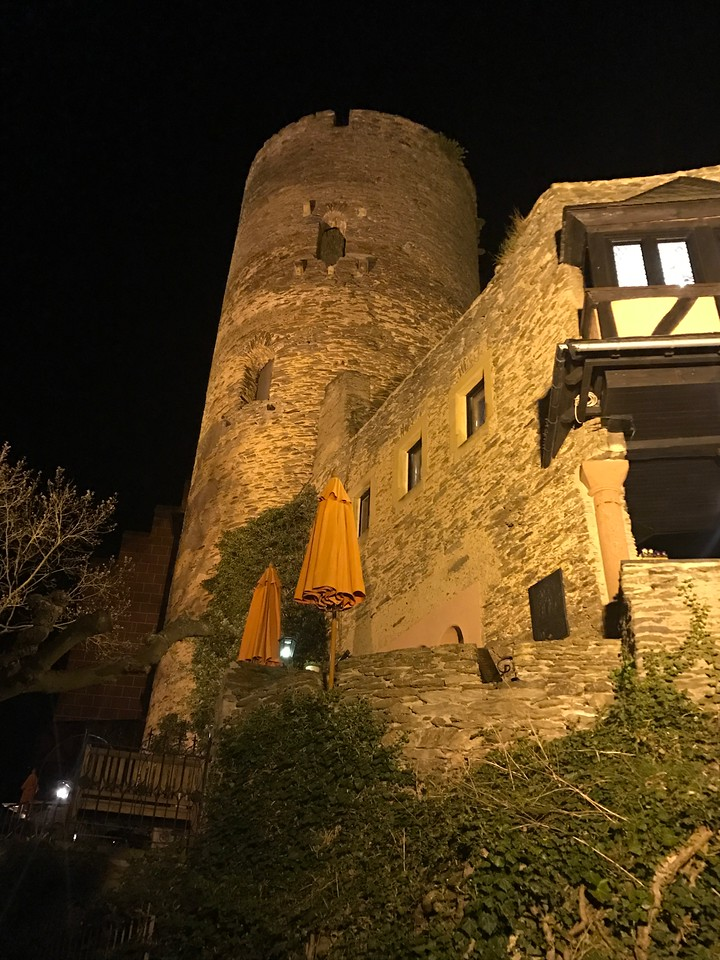 One of the old castle turrets lit up after dark.