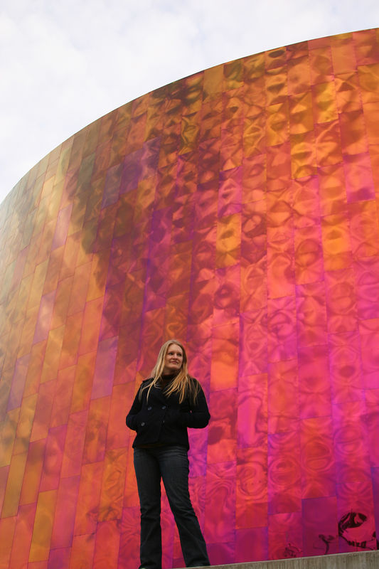 "Jamie in front of the wall of the ""Experience Music Project"" right by the space needle."