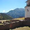 Looking at a piece of the church, Inca ruins, and terraces. Chinchero, Peru.