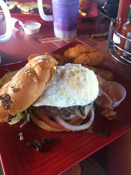 """Stopped for a bite at Jimmy Buffet's """"Cheeseburger in Paradise"""" grill. A bite. Ya.<br /> And, yes that's an egg over-easy on top. I needed a shower after this meal."""