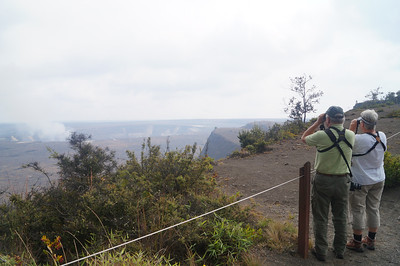 October 18, 2013 - (Hawai'i Volcano National Park [Kilauea Overlook], Hawaii County, Hawaii) -- David & MaryAnne looking into the Kilauea caldron forWhite-tailed Tropicbirds riding the thermals
