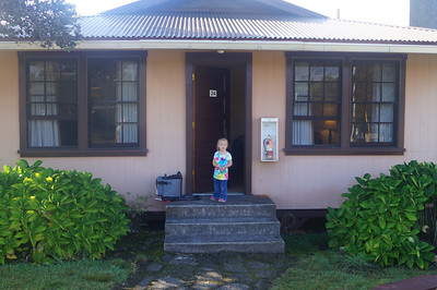 October 18, 2013 - (Kilauea Military Camp, Hawai'i Volcano National Park, Hawaii County, Hawaii) -- Ada at the front door of our cottage [24]