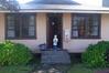 October 18, 2013 - (Kilauea Military Camp, Hawai'i Volcano National Park, Hawaii County, Hawaii) -- Ada at the front door of our cottage [24]