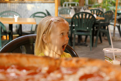 October 16, 2013 - (Kona Pub & Brewery, Kona Brewing Company / Kona-Kailua, Hawaii County, Hawaii) -- Ada behind the pizza at Kona Pub & Brewery