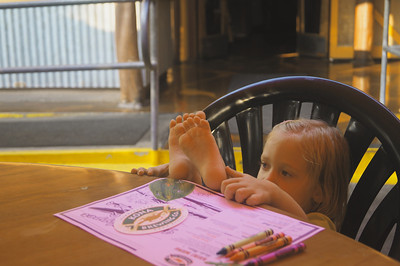 October 16, 2013 - (Kona Pub & Brewery, Kona Brewing Company / Kona-Kailua, Hawaii County, Hawaii) -- Ada with her feet up waiting for dinner at the Kona Pub & Brewery