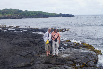 October 17, 2013 - (Punalu'u County [Black Sand] County Park Beach / Nīnole, Kaʻū District, Hawaii County, Hawaii) -- MaryAnne & David on the slippery lava rocks
