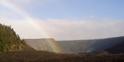 Day Four - Volcanoes National Park.   As Mark and Ruth hiked into the Kilauea Iki caldera, a rainbow appeared.