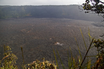 Day Four - Volcanoes National Park.  Mark and Ruth hiked around this crater and through the middle.  It is called Kilauea Iki.  If you look closely (might help to view the original size) you can see people walking across the crater floor.  Also notice the shiny line in the crater floor made by hikers walking across (upper portion of photo).  It is visibile in many of the photos.