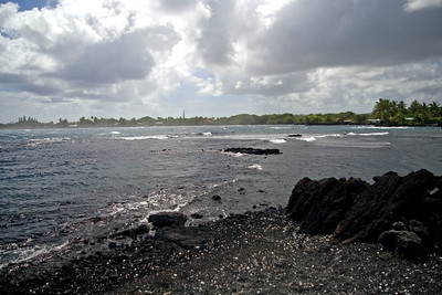 """The entrance to the inlet to Champagne Pond, a heated swimming/snorkling area.  You can see the reef that shields the """"pond"""" from the ocean waves."""