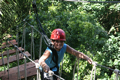 8-17-06 Kauai - Treetop Zipline Eco Adventure - Nate on the swinging bridge - notice that each step is individually hung