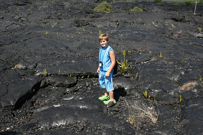 8-13-06 - Secrets of Puna - Nate on the lava.  Plants are starting to grow.