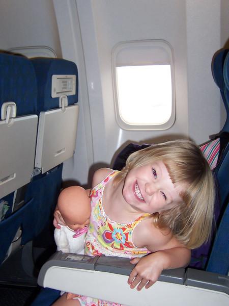 6966  Happy girl on the plane.