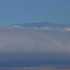 Peak of Mauna Kea from catamaran while whale watching off Kohala Coast