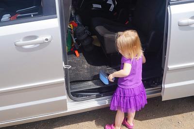 October 12, 2013 -- (North Shore, Waimea, Honolulu County, Hawaii) -- Ada sweeping sand out of the van