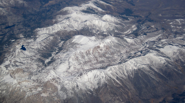 October 11, 2013 (Over snowy California mountains, aboard United Airlines flight)