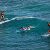 Surfers off Waikiki Beach