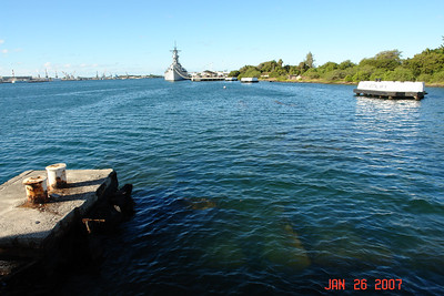 U.S.S. Missouri on left, Arizona Memorial on right.