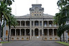 "The 'Iolani Palace structure that exists today is actually the second 'Iolani Palace to sit on the palace grounds. The original palace, built during the reign of Kamehameha III, was a one-story Greek-revival building made out of coral block that was only third the floor area of the present palace. It was purchased by Kamehameha III from Governor Mataio Kekuanaoa of O'ahu who had build it for his daughter (Kamehameha III's niece) Princess Victoria Kamamalu when he moved his capital from Lahaina to Honolulu in 1845. It was constructed as a traditional ali'i residence, in that the palace itself had no sleeping rooms. It just had a throne room, a reception room, and a state dining room as well, with other houses around for sleeping and for retainers. Kamehameha III preferred to live in the grass huts he build around the palace. The building was named, Hale Ali'i meaning (House of the Chiefs). During Kamehameha V reign it was changed to ""'Iolani Palace,"" after his brother Kamehameha IV's given names (his full name was Alexander Liholiho Keawenui 'Iolani). It literally means ""royal hawk."" The Palace served as the official residence of the monarch during the reigns of Kamehameha IV, Kamehameha V, Lunalilo, and the first part of Kalākaua's reign. The original structure was very simple in design and was more of a stately home than a palace, but at the time, it was the grandest house in town.<br /> <br /> King Kamehameha V was the first monarch to envision a royal palace befitting of the sovereignty of a modern state such as Hawaii. He commissioned the construction of Ali'iōlani Hale to be the official palace of the Hawaiian monarchy. The building was constructed across the street from the original 'Iolani Palace structure. It was named after himself (his full name was Lot Kapuaiwa Kalanikapuapaikalaninui Ali'iolani Kalanimakua) it means ""House of the heavenly King"". At the time, Hawaii sorely needed a government building, since the government buildings of the time were small and cramped. Ultimately, Ali'iōlani Hale became an administrative building instead of a palace, housing the judiciary of the Kingdom of Hawaii and various other ministries."