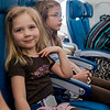 Ava and Kaitlyn on the Hawaiian Airlines flight from Seattle to Maui on the way to the Big Island.