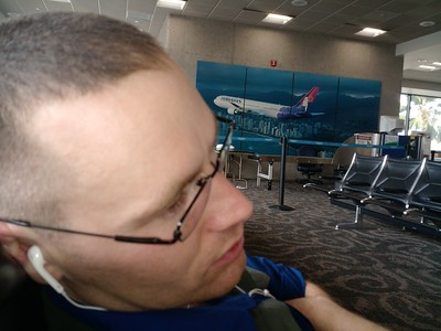Honeymoon, Day 1: In which we travel to Kauai, and acquaint ourselves with the island. Chris about to take a nap at the gate in Honolulu.