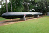 """By the Spring of 1943, the Japanese had designed a Human Torpedo """"Kaiten,"""" or """"Heaven Shaker."""" It had a speed of 40 knots and carried an enormous 3,000 pound warhead. This weapon was successfully tested in July 1944. Although it was easily detected whilst on the surface, and after submerging it left behind a most discernable wake Crews found it hard to steer, and at most, six hours was the ultimate operational time."""