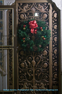 The metal doors (with glass inside surfaces) are spectacular, especially decorated for the season.  We took part in the sequence that would by typical for guests at the Hearst Castle.  Guests would prepare for a casual evening in the accommodations.