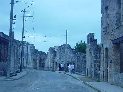 Visit to Oradour - this town with all its inhabitants (all 640 of them) in France was completely destroyed by the Germans. The French kept the town (or what's left of it) and made it into a memorial.