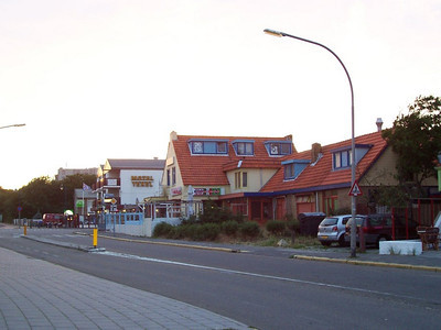 """Still daylight at 10 PM in the village of """"de Koog"""" on Texel. This is a restaurant and shop across the road from our hotel."""