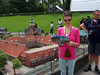 Caroline reading the guidebook for Madurodam: a theme park with miniature models of famous places throughout Holland.
