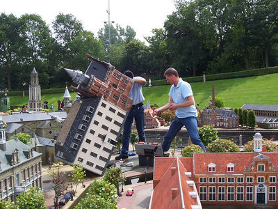 Workers repair the electrical system on one of the models in Madurodam: a theme park with miniature models of famous places throughout Holland.