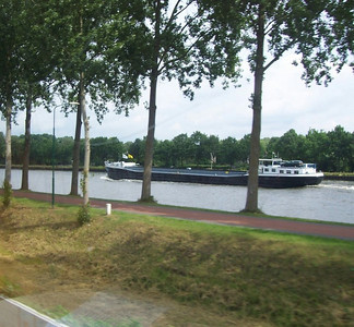 A barge on the Rhine River. Many of these barges navigate in Holland. The owners live on the boats and can unload their car from the deck when docked to go into town for shopping.