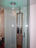 Our shower at our super trendy hotel at Schipol (the Amsterdam airport). This glass cylinder rolls shut to contain the water while you shower in full view of the whole room.