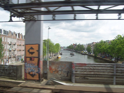 A canal in Utrecht as seen from the train.