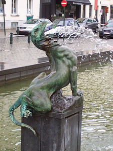 A fountain on a large plaza in Brussels.